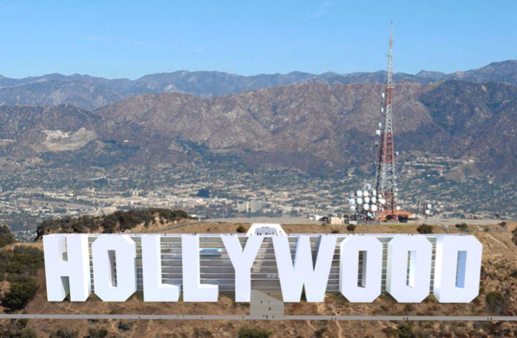 a large mountain in the background with Hollywood Sign in the background