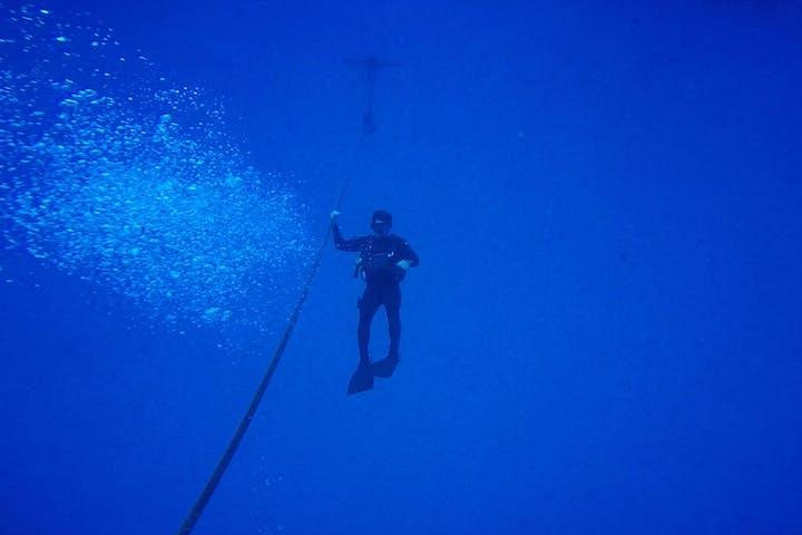 Scuba diver underwater in distance