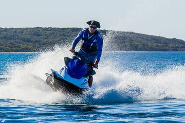 The owner riding a jet ski