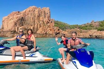 A family of 4 enjoying their jet skis