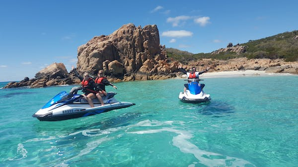 Four happy guests on their jet skis after a tour