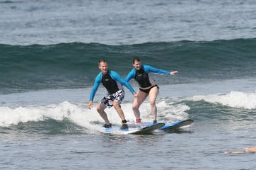 couple surfing lesson maui