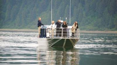 Guests whale watching on Hoonah Bound