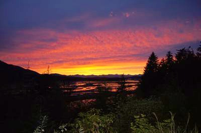 The sun sets over the Alaskan landscape