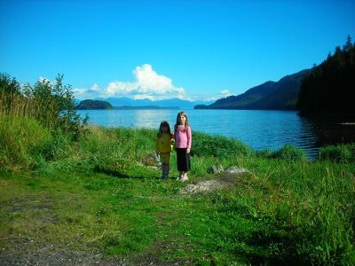 Two girls pose by the bay in Hoonah