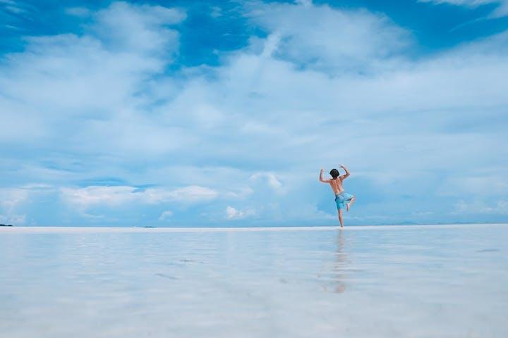 A man posing on the beach
