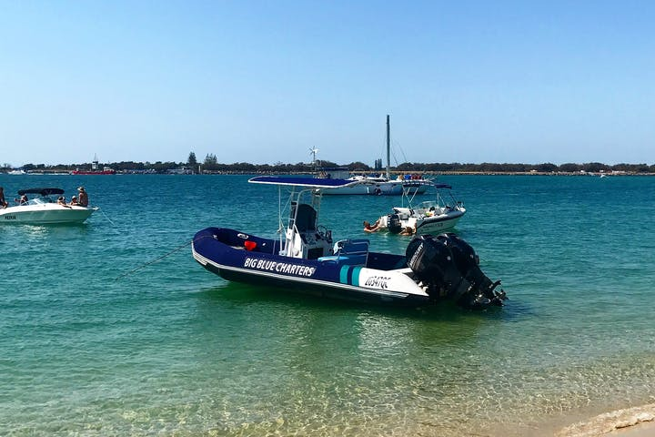 One of the big blue charter boats sitting near the beach