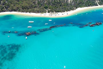 An aerial view of ship wrecks at Tangalooma from above