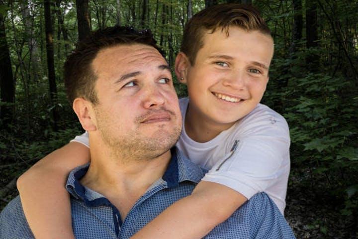 Man looking at his son smiling