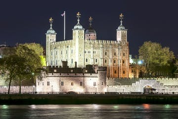 a castle with water in front of Tower of London