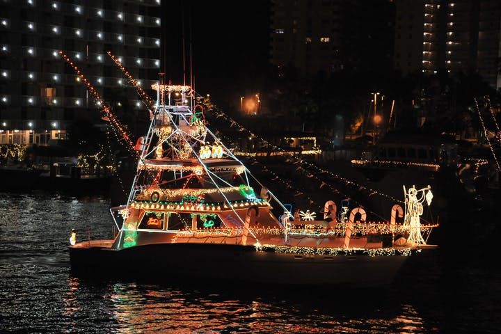 A boat decorated for the nautical mile boat parade