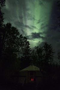 Aurora Borealis above yurt