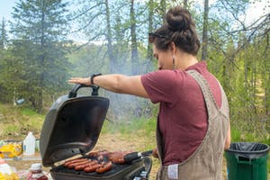 a person standing on a grill