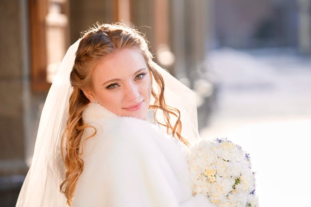 Bride hold bunch of flowers