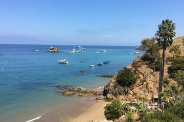 View of Catalina Island and sailboats off the beach