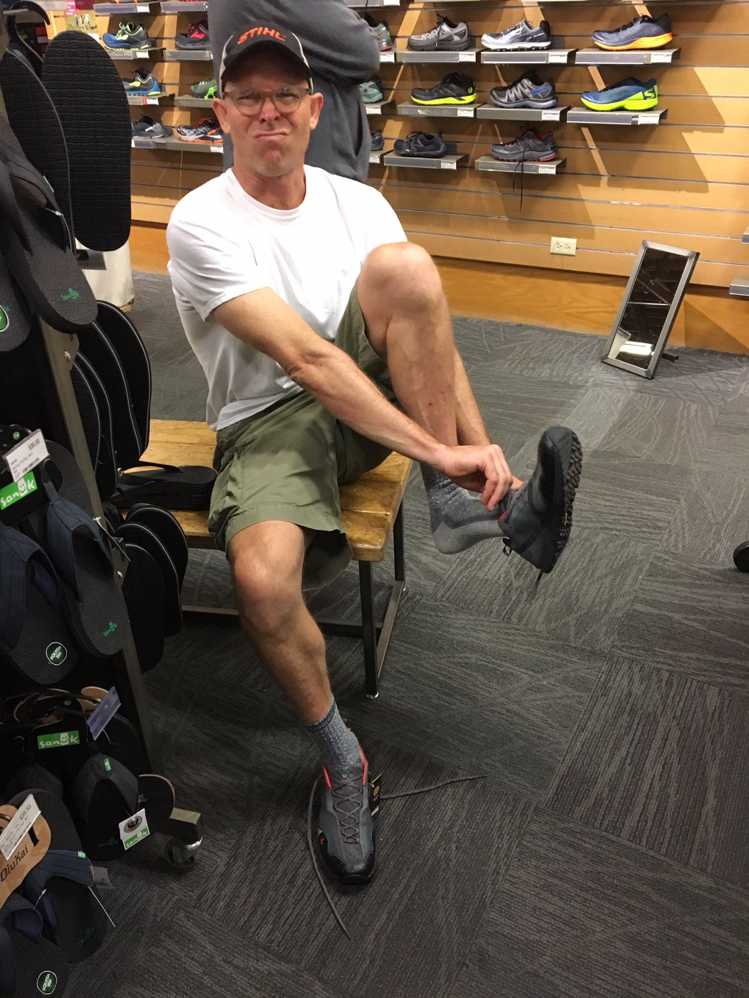 trying on shoes at REI