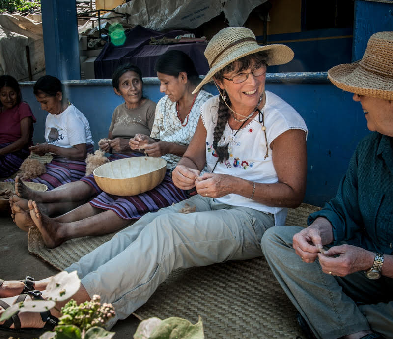 guests learning about natural cotton with artisans in Oaxaca