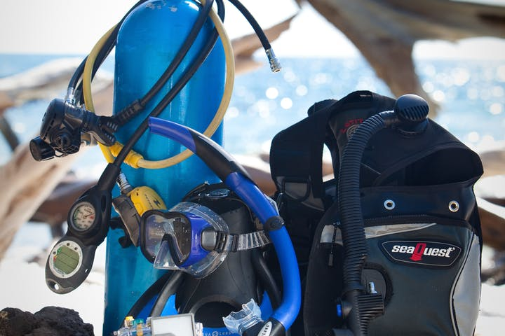 Scuba diving gear sitting on rock