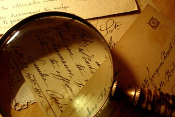 magnifying glass with cursive