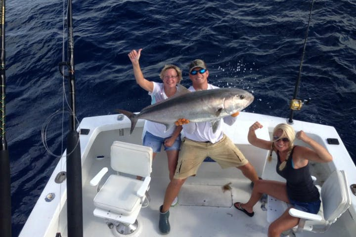 Private Charter Image 1 happy fishermen with big fish