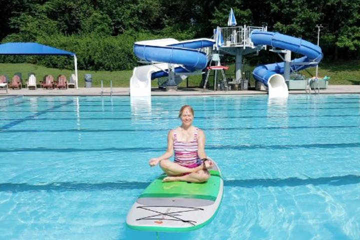 Yoga instructor Sandy leading a SUP yoga class in the pool