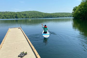 a person paddle boarding on shepherd lake