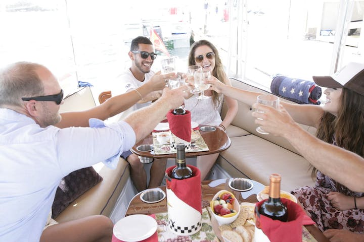 enjoying wine on a chartered boat