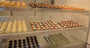 A bakery display case finishes our food tour with a sweet ending.