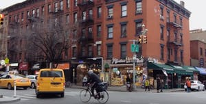 A man biking around the West Village in NYC