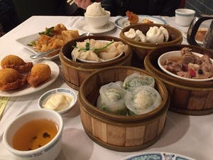 A variety of dim sum dumplings and side dishes