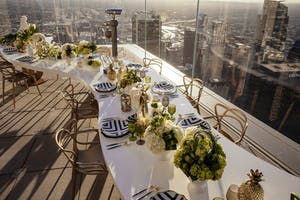 Rooftop table with a view of Downtown LA