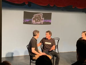 2 people on stage at an improv class