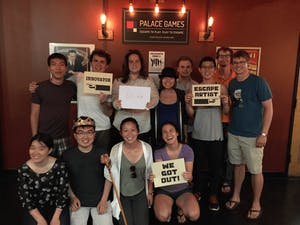 group of people with their completion certificates from the escape room