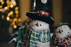 an ornamental snowman and christmas tree