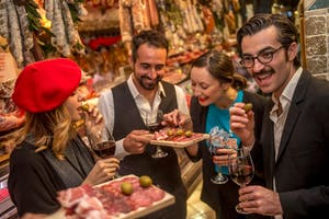 People enjoying samples of food on a food tour