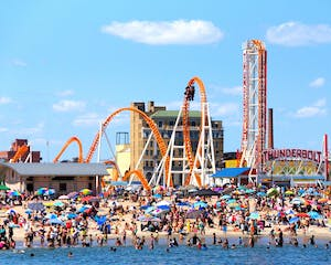 image of the beach and roller coaster at Coney Island in NY