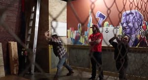 two people throwing axes