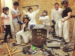 Group photo of people in a rage room