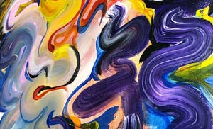 a close up of swirls of colors painted on a canvas