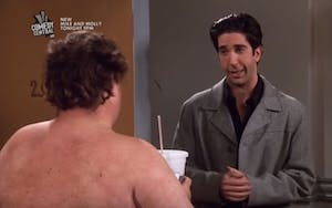 David Schwimmer looking at the camera and a naked man with his back to the camera