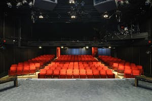an auditorium of red seats