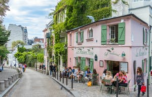 People siting on a street in Montmartre Paris