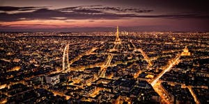 Paris at night with sunset