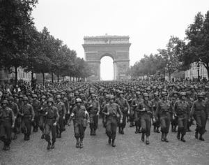 A group of nazi soldiers in front of Arc de Triomphe