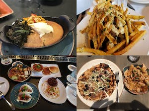 a bunch of different types of food on different plates including cheesy fries, pancakes, and pizza