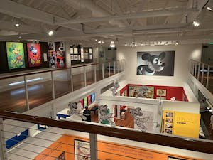 a view from a balcony showing several photos of Micky Mouse
