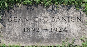 "The front of a ground headstone that reads ""Dean C. O'Banion. 1892 - 1924"""