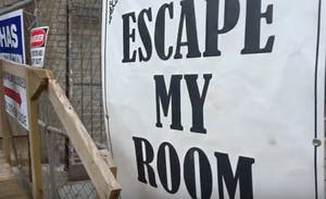"a close up of a sign that says ""escape my room"""