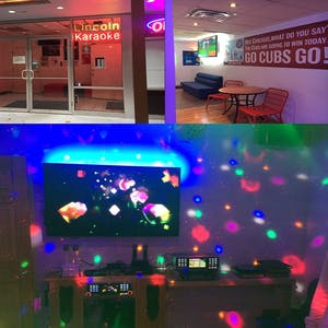 a room with lots of colorful lights and a large TV screen