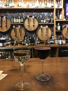 a bar in a winery with barrel taps
